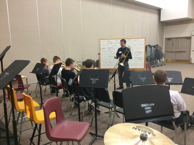9th Grade trombone players talking jazz trombonists with Mike Conrad